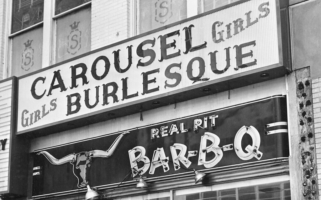 The entrance and marquee of the Carousel burlesque club, located on the second floor on Commerce Street in Dallas, Texas, is shown on November 24, 1963, the day the club's operator Jack Ruby shot John F. Kennedy's accused assassin, Lee Harvey Oswald.  (AP Photo)