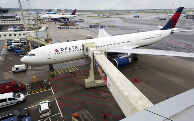 Illustrative: A Delta aircraft is seen on Schiphol airport in Amsterdam, Wednesday, Aug. 7, 2013.  (AP Photo/Evert Elzinga)