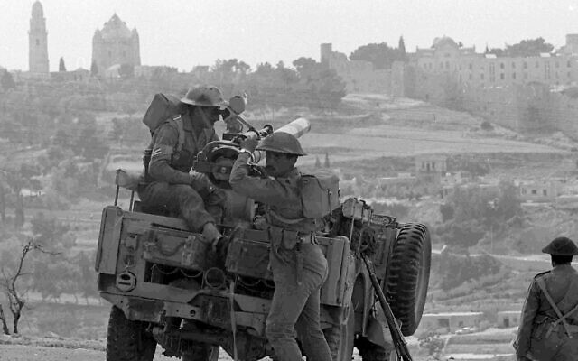 Jordanian troops ready a recoilless anti-tank gun on a jeep, in Jerusalem, May 31, 1967. In the background is the Notre Dame De France Church and Hospital, left, inside the Israeli sector of Jerusalem.  (AP Photo)