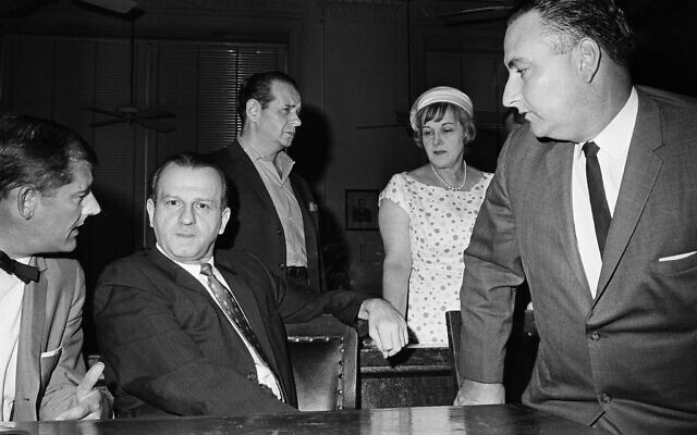 Jack Ruby talks with defense attorney Sam Houston Clinton, Jr., left, July 24, 1965, after District Judge Louis Holland denied a defense motion for a hearing to disqualify Judge Joe B. Brown from further proceedings in the case in which Ruby was convicted and sentenced to death for the shooting of presidential assassin Lee Harvey Oswald. (AP Photo/Ferd Kaufman)