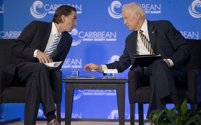 Then US Vice President Joe Biden (R) leans over to talk with Amos Hochstein, a State Department Special Envoy for International Energy Affairs, before speaking at the Caribbean Energy Security Summit at the State Department in Washington, January 26, 2015. (Pablo Martinez Monsivais/AP)