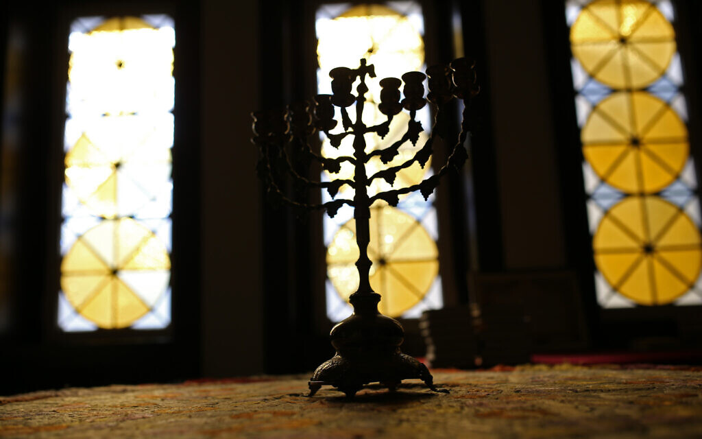 A nine-branched Jewish candelabrum, or Hanukkah Menorah, rests on a table in the main Jewish synagogue in Lisbon, May 5, 2015. (AP Photo/Francisco Seco)