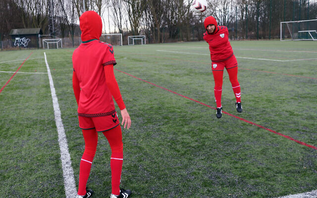 Illustrative: Afghani national soccer team player Shabnam Mabarz, seen from behind, watches as Khalida Popal, the former Afghanistan national women's team captain, heads the ball in Copenhagen on March 8, 2016. (AP Photos/Jan M. Olsen)