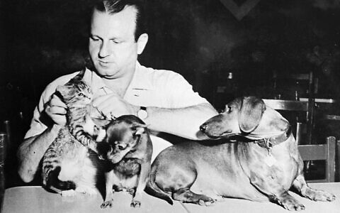Dallas nightclub owner Jack Ruby, who killed Lee Harvey Oswald, is shown with his pets. This undated photo was on the wall of Ruby's office. (AP Photo)