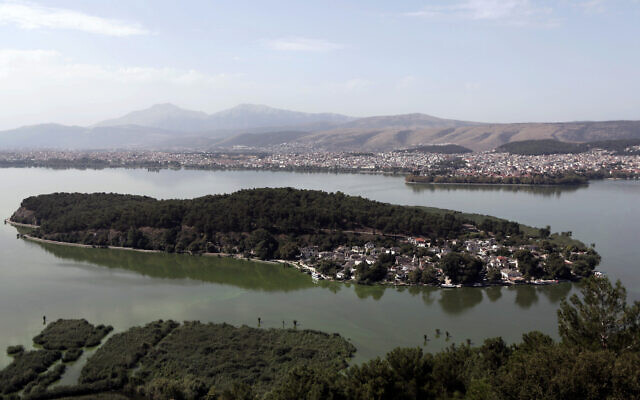This Aug. 22, 2014, aerial photo shows a view of Pavmotis Lake, with the lake isle and city of Ioannina, in northwestern Greece (AP Photo/Thanassis Stavrakis)