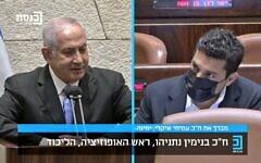 Opposition leader Benjamin Netanyahu (L) addresses Yamina MK Amichai Chikli following the rookie lawmaker's maiden Knesset speech, August 3, 2021. (Screen capture: Knesset Channel)
