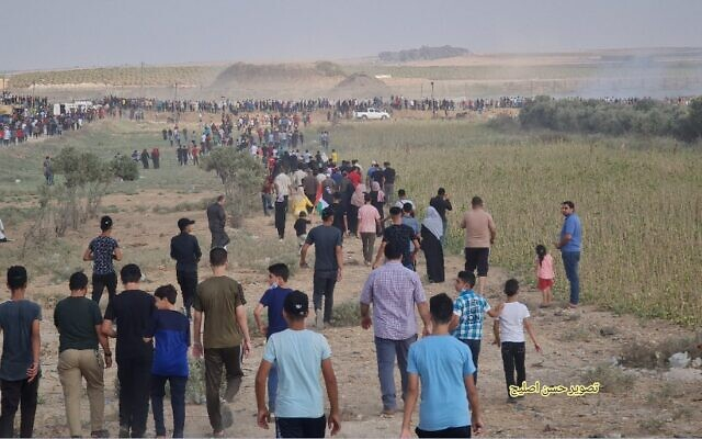 Gazans march towards border fence with Israel during a protest, on Saturday, August 21, 2021. (Credit: Hassan Islayeh)