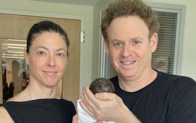 Merav Michaeli and her partner Lior Schleien are seen with their newborn, Uri. (Facebook photo)