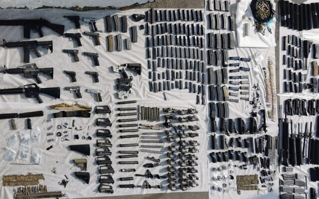 Officers uncovered a number of firearms and dozens of weapon parts in Hebron, August 27, 2021. (Israel Police)