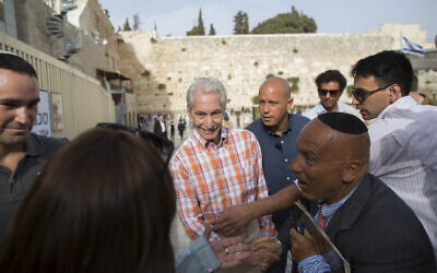 Charlie Watts, drummer for The Rolling Stones, seen visiting the Western Wall in Jerusalem's Old City on Tuesday, June 3, 2014, a day before the band's concert in Tel Aviv. (Yonatan Sindel/Flash 90)