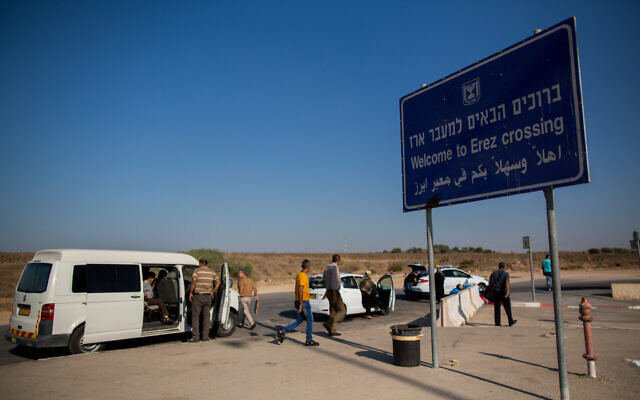 Illustrative: Palestinians are seen on the Israeli side of the Erez Crossing near the border with the Gaza Strip on September 3, 2015. (Yonatan Sindel/Flash90)