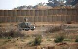 Illustrative: A IDF military vehicle drives near the border with Gaza east of Bureij on December 6, 2019. (Hassan Jedi/Flash90)