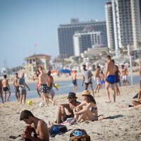 Israelis enjoy the beach in Tel Aviv on June 08, 2021 (Miriam Alster/FLASH90)