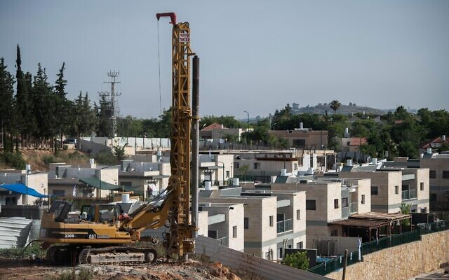 Construction work is seen in the West Bank settlement of Yakir, on June 11, 2020. (Sraya Diamant/Flash90)