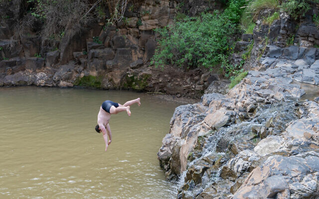 Israelis enjoy the Tavor Stream nature reserve, on March 19, 2021. (Yahav Gamliel/Flash90)