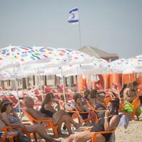 Israelis at the beach in Tel Aviv, June 29, 2021. (Miriam Alster/FLASH90)