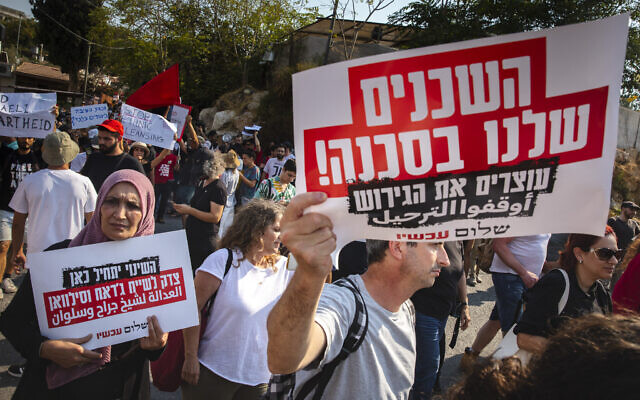 Protesters demonstrate in the East Jerusalem neighborhood of Sheikh Jarrah on July 30, 2021. The sign reads, 'Our neighbors are in danger!' (Olivier Fitoussi/ Flash90)