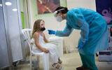 Children take test samples as part of a coronavirus test at the Sheba Medical Center in Ramat Gan. August 02, 2021. (Miriam Alster/FLASH90)