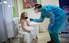 Children take test samples as part of a coronavirus test at Sheba Medical Center in Ramat Gan, August 02, 2021. (Miriam Alster/FLASH90)