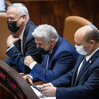 (From left to right) Defense Minister Benny Gantz, Foreign Minister Yair Lapid and Prime Minister Naftali Bennett at the Knesset in Jerusalem, on August 2, 2021. (Yonatan Sindel/Flash90)