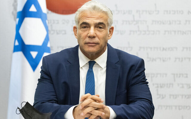 Foreign Minister Yair Lapid heads a Yesh Atid faction meeting at the Knesset in Jerusalem, on August 2, 2021. (Yonatan Sindel/Flash90)