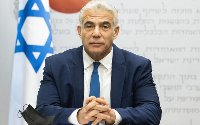 Foreign Minister Yair Lapid speaks during a Yesh Atid faction meeting at the Knesset on August 2, 2021. (Yonatan Sindel/Flash90)