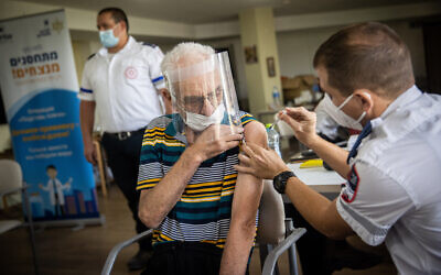 A resident from the Amigor elder care facility receives a third dose of the coronavirus vaccine on August 4, 2021 (Yonatan Sindel/Flash90)