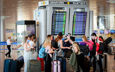 Travelers in the departures hall at Ben Gurion International Airport on August 5, 2021 (Avshalom Sassoni/FLASH90)