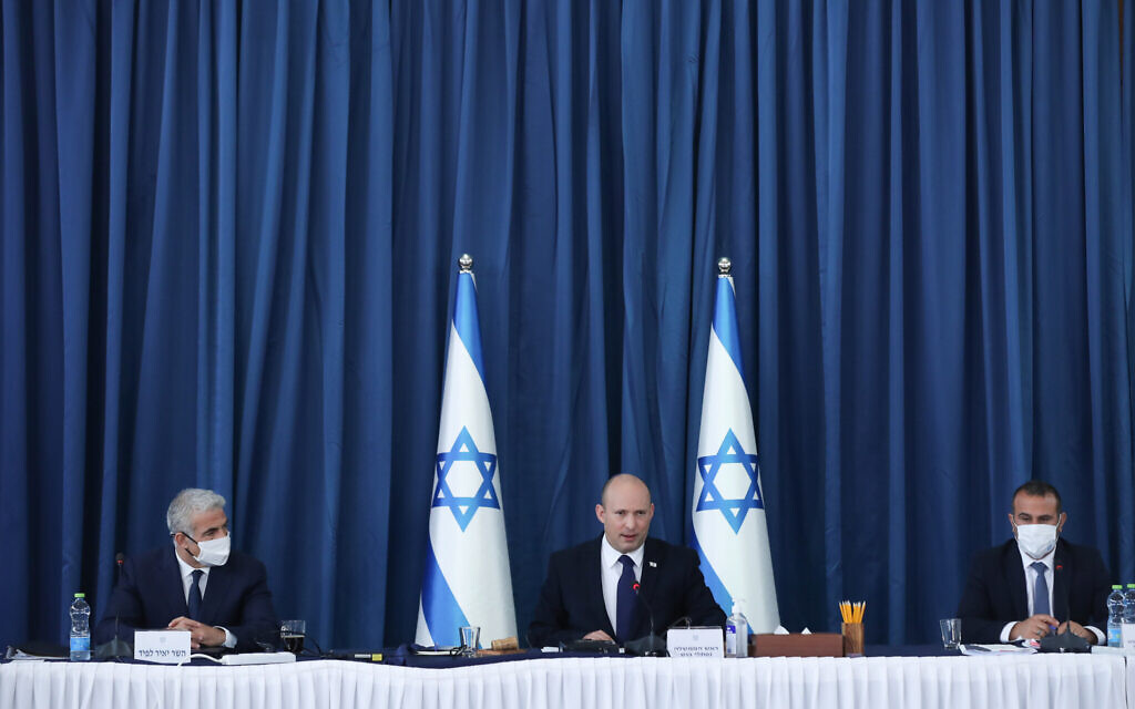 Prime Minister Naftali Bennett (C) and Minister of Foreign Affairs Yair Lapid (L) attend a cabinet meeting at the Ministry of Foreign Affairs in Jerusalem on August 8, 2021.  (Ohad Zwigenberg/POOL via Flash90)