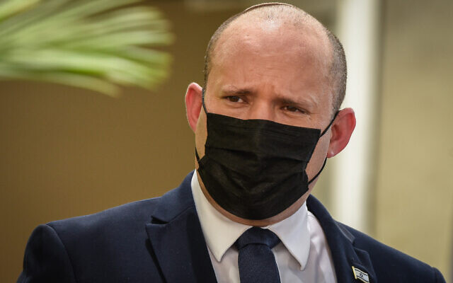 Prime Minister Naftali Bennett attends an inauguration ceremony marking the opening of a new police station in the northern Israeli city of Kiryat Ata, on August 11, 2021. (Roni Ofer/Flash90)