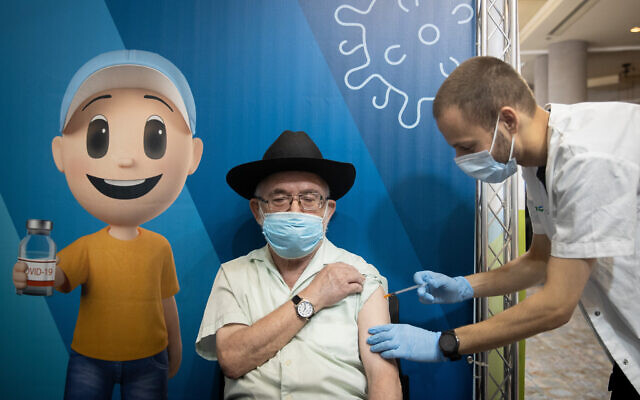 Israelis receive their third dose of the COVID-19 vaccine at a temporary Clalit health care center in Jerusalem, on August 12, 2021. (Yonatan Sindel/Flash90)