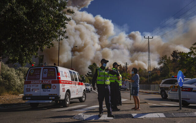 Emergency services at the site of a fire which broke out in a forest near Beit Meir, outside of Jerusalem on August 15, 2021. (Yonatan Sindel/Flash90)