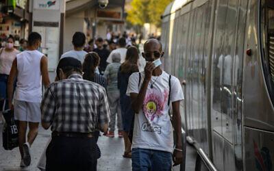 People walk along Jaffa Street in Jerusalem, on August 18, 2021. (Olivier Fitoussi/Flash90)
