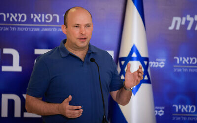 Prime Minister Naftali Bennett recieves his third dosage of the COVID-19 vaccine at Meir Hospital in Kfar Saba, on August 20, 2021. (Olivier Fitoussi/Flash90)