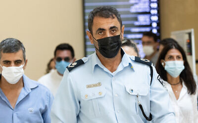 Israel Police Northern District Chief Shimon Lavi arrives to testify before the Meron disaster commission of inquiry on August 22, 2021. (Yonatan Sindel/Flash90)