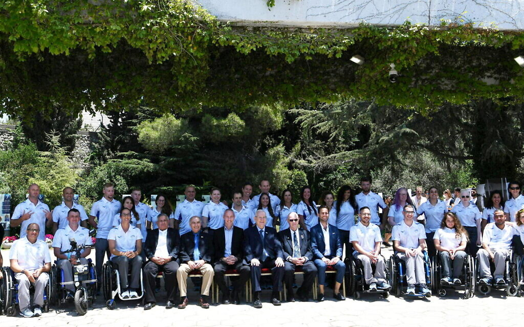 Israel's Paralympic delegation to Tokyo poses for a photo with then-president Reuven Rivlin on June 23, 2021, in Jerusalem. (Amos Ben Gershom/GPO)
