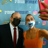 Prime Minister Naftali Bennett meets with actress and social media influencer Shira Levi in Tel Aviv on August 5, 2021. (Haim Zach / GPO)