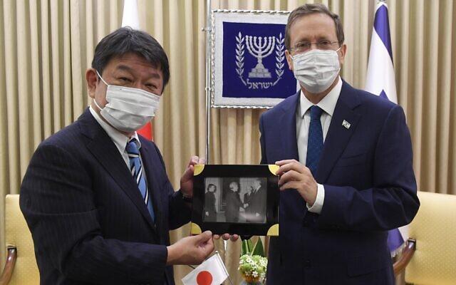 President Isaac Herzog meets Japanese Foreign Minister Toshimitsu Motegi in Jerusalem on August 18, 2021. (Mark Neyman/GPO)