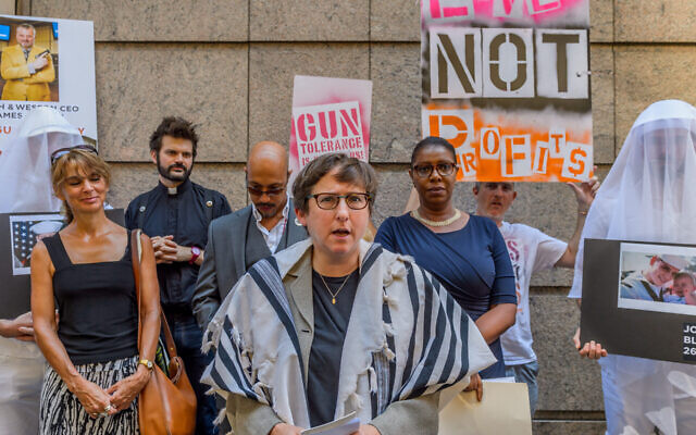 Rabbi Sharon Kleinbaum of Congregation Beth Simchat Torah joined others at a 2016 press conference condemning the appearance of Smith & Wesson's CEO at a conference. (Erik McGregor/LightRocket via Getty Images/JTA)
