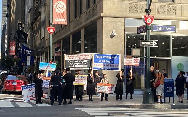 Anti-Israel Neturei Karta activists protest across the street from pro-Israel demonstrators in Manhattan on August 12, 2021. (Jacob Magid/Times of Israel)