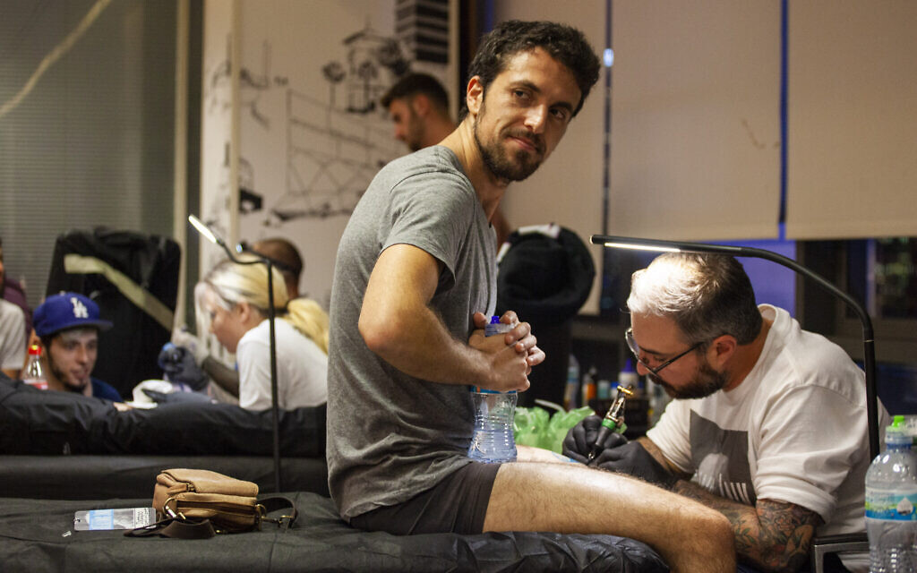 Healing Ink, a project of Artists 4 Israel, provides free tattoos to those injured in terrorist and antisemitic attacks. (Dillon Meyer)