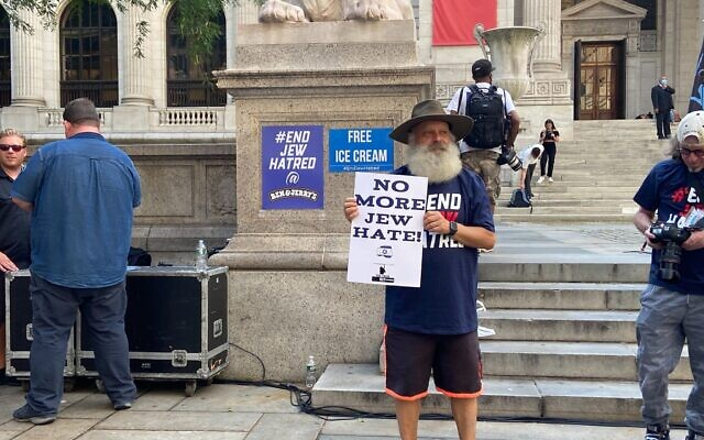 A pro-Israel demonstrator outside the New York Public Library in Manhattan on August 12, 2021. (Jacob Magid/Times of Israel)