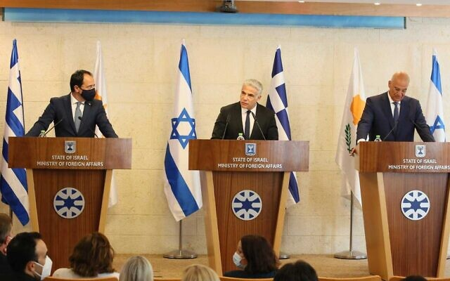 Foreign Minister Yair Lapid (center) with his Greek counterpart Nikos Dendias (right) and Cypriot counterpart Nikos Christodoulides, at the Foreign Ministry in Jerusalem, August 22, 2021. (Foreign Ministry)