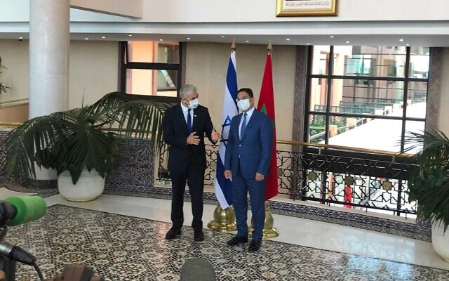 Foreign Minister Yair Lapid (left) and his Moroccan counterpart, Nasser Bourita, at the Foreign Ministry in Rabat on August 11, 2021. (Lazar Berman)