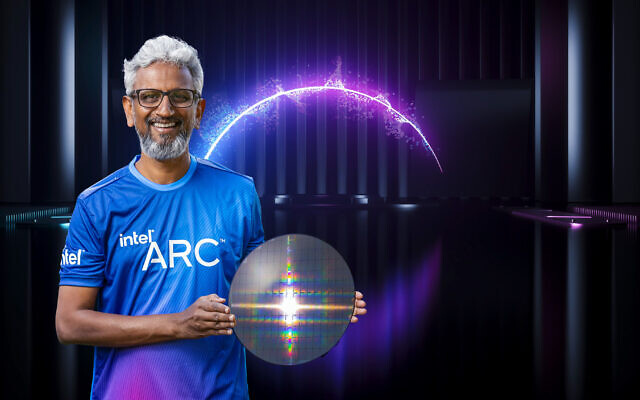 Raja Koduri, Intel senior vice president and general manager of the Accelerated Computing Systems and Graphics Group, displays a wafer with Intel Arc high-performance discrete graphics hardware as part of a presentation during Intel Architecture Day 2021. The virtual event was held in August 2021. (Intel Corporation)