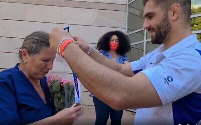 Screen capture from video of judoka Peter Paltchick presenting his mother Larissa with the bronze medal he won at the Tokyo Olympic Games, August 2, 2021. (Instagram)