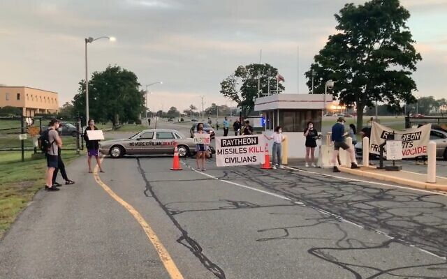 Screen capture from video of protestors outside a plant of US defense contractor Raytheon in Rhode Island, on August 12, 2021. (Twitter)