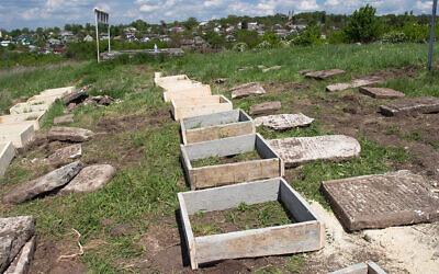 Renovation work at the Jewish cemetery in Sataniv, Ukraine, in 2021. (Dmitry Polyukhovich/Jewish Heritage Europe via JTA)