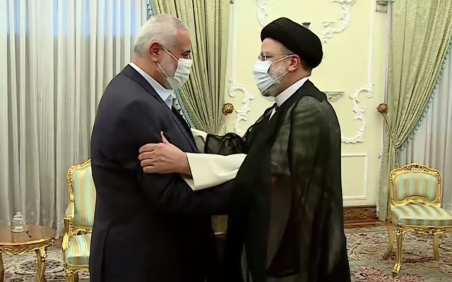 Hamas leader Ismail Haniyeh (L) greets new Iran President Ebrahim Raisi at the latter's office on August 6, 2021. (Screen capture/YouTube)