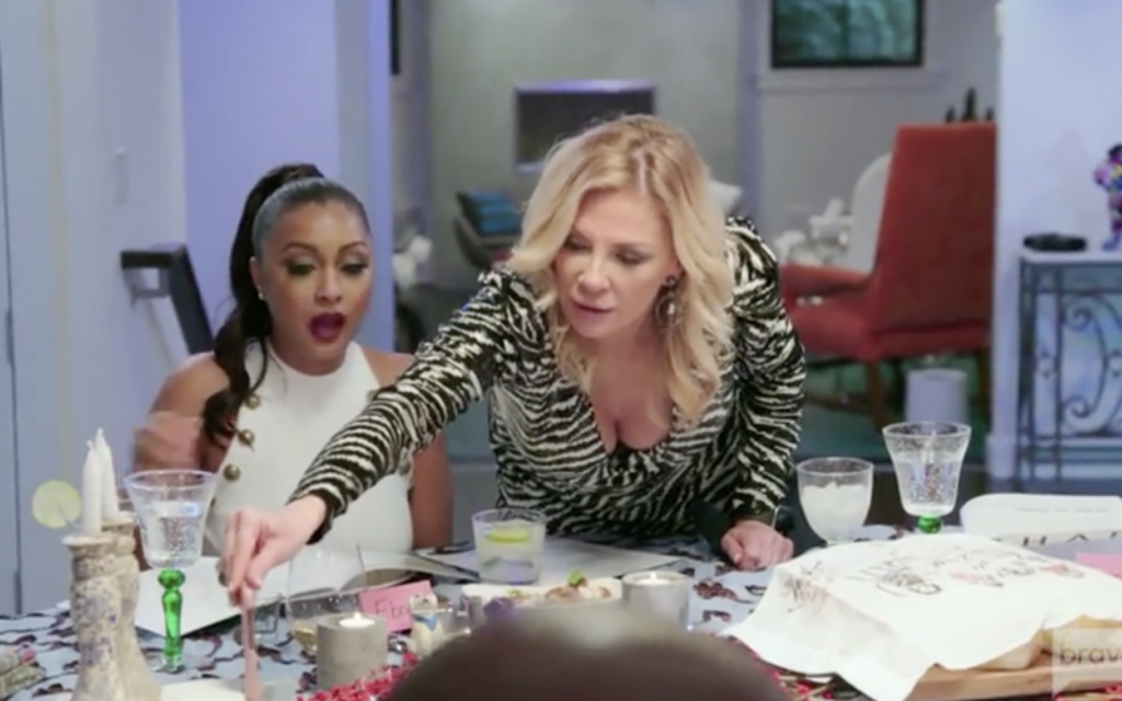 """Eboni Williams, left, convened her fellow cast members for a Shabbat dinner on Bravo's """"The Real Housewives of New York City,"""" in an episode that aired Aug. 11, 2021. (Screen capture via JTA)"""